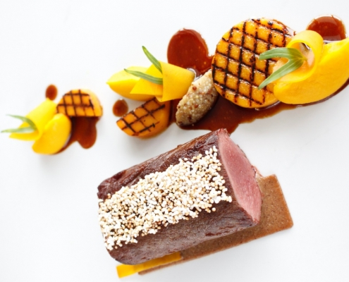 Pan seared fillet of venison served with a cream of hazelnut butternut squash mustard and amaranth 1 495x400 - Resto Juara